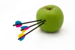 Frecce sulla mela Fotografia Stock Libera da Diritti