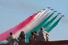 Frecce Tricolore, Three-Colored Arrows in Ladispoli, Italy. The Frecce Tricolore, the Three-Colored Arrows, fly all over Italy for celebrations, this one to royalty free stock photography