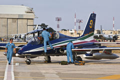 Frecce Tricolori Crew. LUQA, MALTA - 25 SEP - Crew members from the Italian Frecce Tricolori aerobatic team check their aircraft before an aerial display during Royalty Free Stock Photos