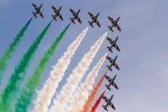 Frecce Tricolori: italian aerobatic Team performing  alona , low pass with italian flag colors smokes Stock Photo
