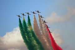 Frecce Tricolori - Italian Air Force Acrobatic Team. Frecce Tricolori in formation during an exibition with tricolor smokes Royalty Free Stock Photography