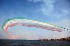 Frecce Tricolori - Italian Air Force Acrobatic Team. Frecce Tricolori with tricolor smokes during an exibition Stock Image