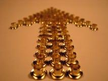 Freccia dei ribattini dell'oro Fotografia Stock