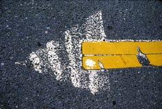 Freccia dell'asfalto Immagini Stock