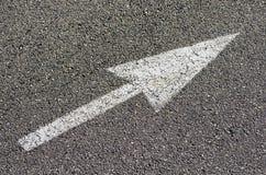 Freccia su pavimentazione Fotografie Stock