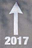 Freccia sulla parola scritta 2016 della strada asfaltata Fotografia Stock