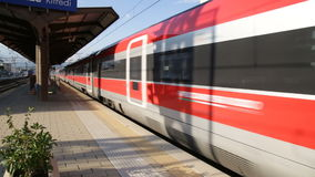 Frecciarossa 1000 train is passing. Frecciarossa 1000 trenitalia high speed train is passing from the station stock footage