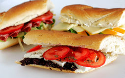 Frech baguette fresh sandwiches. Fresh sandwiches with white cheese, tomato and olive pate Stock Image