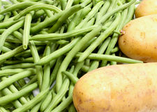 Frech-beans and potatoes. French-beans fresh and raw potatoes not coocked yet Royalty Free Stock Photos