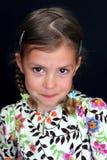 Freches Mädchen mit Rissen in den Augen Stockfoto