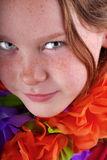Freckle Faced Girl and Leis Stock Images