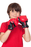 Freckled boy with boxing gloves Stock Photography