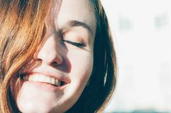 Freckled brunette young woman smiling royalty free stock photos