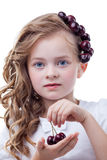 Freckled girl with cherries posing at camera Royalty Free Stock Photo