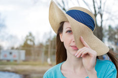 Freckled girl covering one eye by hat Royalty Free Stock Photos