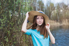 Freckled girl in hat on the lake Stock Photo