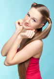 Freckled girl in red dress Stock Image