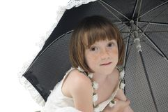 Freckled model posing with umbrella Stock Photography