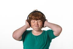 Freckled red-hair boy listening music. Royalty Free Stock Photos