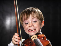Free Freckled Red-hair Boy Playing Violin. Stock Photo - 32295010