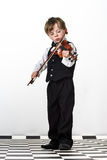 Freckled red-hair boy playing violin. Stock Photo