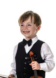 Freckled red-hair boy playing violin. Royalty Free Stock Photography