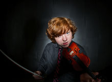 Freckled red-hair boy playing violin Stock Images