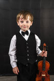Freckled red-hair boy playing violin. Stock Images