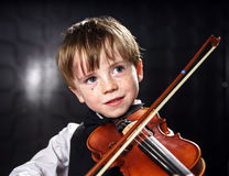 Freckled red-hair boy playing violin. Stock Photography