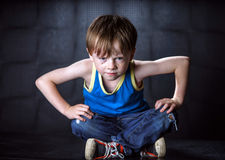 Freckled red-hair boy posing on dark background. Emotions Stock Image