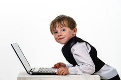 Freckled red-hair little boy with laptop. Stock Images