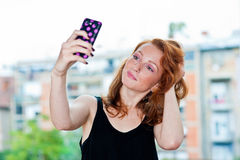 Freckled woman making selfie outside Royalty Free Stock Photo
