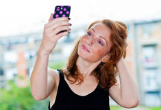 Freckled woman making selfie outside Royalty Free Stock Photography