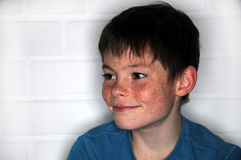Freckles. Happy teenager  boy with  bright eyes and a lot of freckles Stock Photo