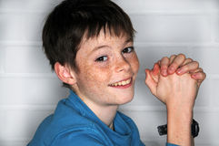 Freckles. Happy teenager  boy with  bright eyes and a lot of freckles Royalty Free Stock Photography