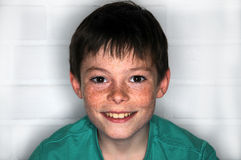 Freckles. Happy teenager  boy with  a lot of freckles Royalty Free Stock Photos