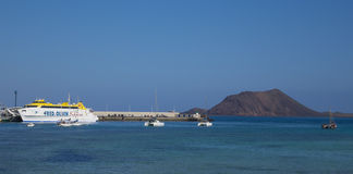 Fred Olson express in Corralejo harbor harbour with Lobos in the Stock Image