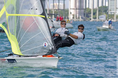 Fred Strammer & Zach Brown lead the 49er fleet at the 2013 ISAF. MIAMI, February 2, 2013 - Theater-style racing is designed to attract spectators, sponsors Royalty Free Stock Photos