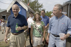 Fred Thompson walking with Miss Pork and U.S. Senator from Iowa Royalty Free Stock Images