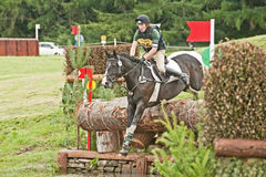 Freddie Keith riding for Great Britain at Blair. Freddie Keith competitor number 36 on Springwind Flying Fox riding for Great Britain and clearing the big log at Stock Photos