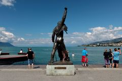 Freddie Mercury`s Statue in Montreux Lake Geneva. The statue of Freddie Mercury overlooking Lake Geneva in Montreux Switzerland. Freddie is surrounded by fans of stock photos