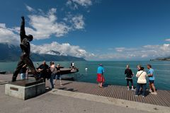 Freddie Mercury`s Statue in Montreux Lake Geneva. The statue of Freddie Mercury overlooking Lake Geneva in Montreux Switzerland. Freddie is surrounded by fans of stock photography