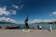 Freddie Mercury`s Statue in Montreux Lake Geneva. The statue of Freddie Mercury overlooking Lake Geneva in Montreux Switzerland. Freddie is surrounded by fans of stock images