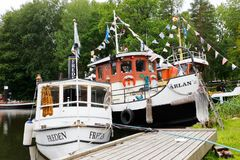 Freden and Arlan ships. Arboga, Sweden - July 9, 2018: The ships Freden and Arlan moored at Hjalmare docka in the Hjalmare canal stock photography