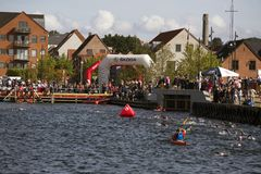 Triathlon in Frederiia old harbour. Fredericia, Denmark - September 3 2017: Target area for the swimming element of the triathlon competition. Challenge Denmark stock photos