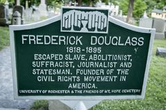 Frederick Douglass` grave at Mt. Hope Cemetery. A sign near the final resting place of famous american Frederick Douglass at the the historic Mount Hope Cemetery Royalty Free Stock Photos