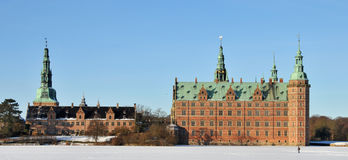 Frederiksborg Castle. Winter view of Frederiksborg Castle at Hilleroed in Denmark with frozen Palace Lake in the foreground Royalty Free Stock Photos