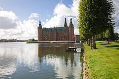 Frederiksborg Castle. Danish: Frederiksborg Slot is a palatial complex in Hillerød, Denmark. It was built as a royal residence for King Christian IV of Denmark Royalty Free Stock Photography