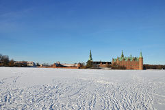 Frederiksborg Castle, Denmark. Frederiksborg Castle in Hilleroed, Denmark in the winter with frozen lake Royalty Free Stock Image