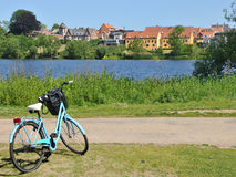 Frederiksborg Castle, Denmark. Park by the Frederiksborg Castle, the famous Danish Castle in Hilleroed with bicycle and view to town Stock Images